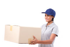 Fast, happy, female delivery service staff with parcel or carton Royalty Free Stock Photos