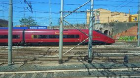 Fast Italian train passing from station of Rome to Venice, 01 May, 2018. Fast modern Italian train connecting Rome to Venice, high-speed passenger train Italo stock video