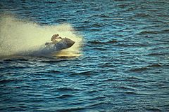 Fast jet ski. Jet skier going fast on waves Royalty Free Stock Photography