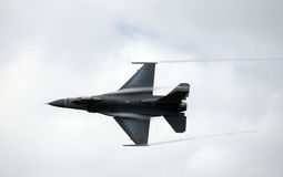 Fast jetfighter. Military jet at high speed with contrail Stock Image