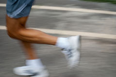 Fast jogging. Man jogging in the park royalty free stock image