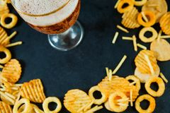 Fast junk food concept onion rings french fries potato chips Royalty Free Stock Image