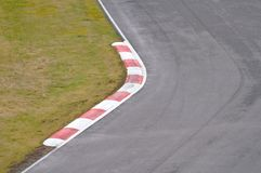 Fast left. Curve on a race track surrounded with green lawn asphalt car cars circuit competition danger drivers driving finish formula go carting grass motor stock photography