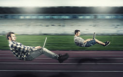 Fast levitating mans on a running track Royalty Free Stock Image
