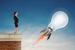 Fast lightbulb as a rocket ready to fly fast. Concept of new super idea. Fast lightbulb as a rocket ready to fly fast in the sky. Concept of new super idea stock photos