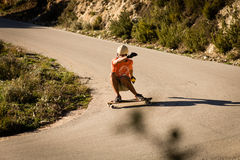 Fast longboard downhill skater Royalty Free Stock Images