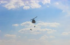 Fast-lope are  leave helicopter. Stock Image