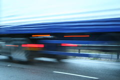 Fast Lorry. Abstract blurred lorry on wet road stock image