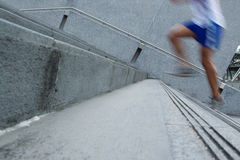 Fast Man running up stairs Stock Photography