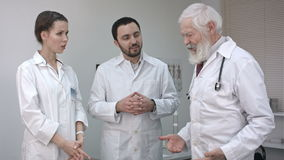 Fast meeting. Three confident doctors discussing something. stock video