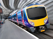 Fast Modern Passenger Train with Motion Blur. Fast Modern Passenger Train with Motion Radial Zoom Blur, Titled view Royalty Free Stock Image