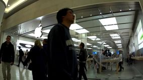 Fast motion of apple store inside mall stock video footage