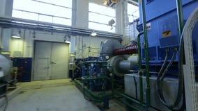 Fast Motion around Powerful Industrial Compressor. KAZAN, TATARSTAN/RUSSIA - JUNE 12 2016: Fast motion around large metal powerful industrial compressor with stock video footage