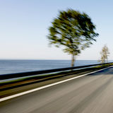 Fast motion blur on coastline road Royalty Free Stock Photography