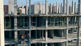 Fast motion of men working in the building under construction stock video footage