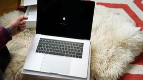 Fast motion time lapse Man unboxing new Apple MacBook pro 15 laptop computer. Paris, France - Circa 2018: Time lapse fast motion of man unboxing Apple MacBook stock video footage