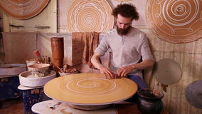 Fast motion video of a Potter working stock footage