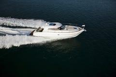 A fast motor boat sailing through the sea stock photo