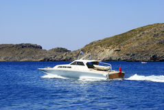 Fast motor boat with splash and wake Royalty Free Stock Photo
