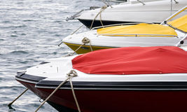 Fast motor boats at anchor. Anchored fast motor boats moored in harbor Stock Images