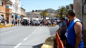 Fast Motorcycles. The motorcycles speed past very close to the crowd at the Algueña road circuit in Spain stock video