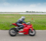 Fast motorcyclist Stock Image