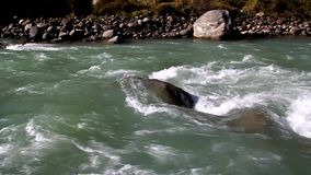 Fast, mountain river flowing among stones stock video footage