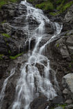Fast mountain waterfall in vertical orientation Royalty Free Stock Image