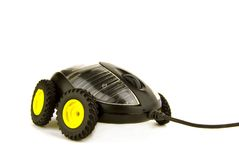 Fast mouse. A computer mouse on wheels on white background Stock Photo