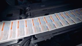 Fast movement of ready-made newspapers on the conveyor in a printing house. stock video