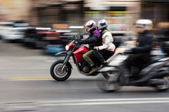 Fast moving bike Rome royalty free stock image
