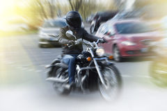 Fast moving biker on motorcycle Royalty Free Stock Image