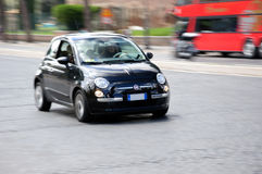 Fast moving black fiat 500 Stock Image