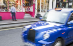 Fast moving blurred taxi in London.  Stock Images