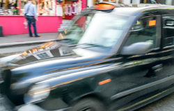 Fast moving blurred taxi in London.  Stock Photography