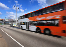 Fast moving bus on highway Royalty Free Stock Images
