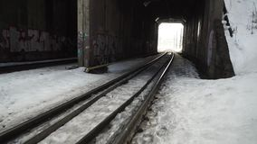Fast moving camera to dark old railway tunnel. Fast moving camera to dark old railway tunnel toward bright light in the end stock footage