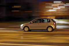 Fast moving car. Fast moving small city car during the night Stock Photos