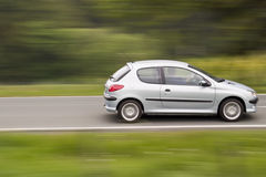 Fast moving car. With blurred background due to following the car royalty free stock images