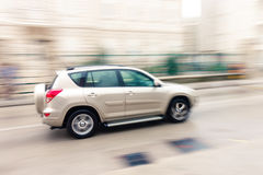 Fast moving car on the city roadway in motion blur Stock Images