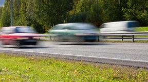 Fast moving cars Stock Photo