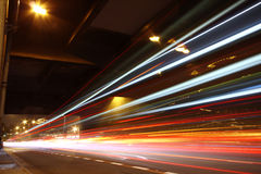 Fast moving cars. At night royalty free stock photography