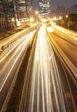 Fast moving cars at night Royalty Free Stock Image