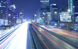 Fast moving cars at night Stock Image