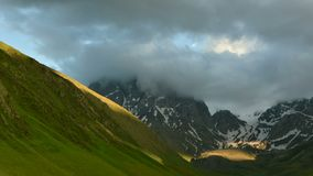 Fast-moving clouds over the Chaukhi mountain range stock footage