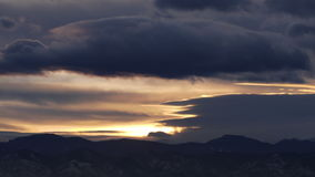 Fast Moving Clouds at Sunset. Over the Rocky Mountains of Colorado. HD 1080p time lapse stock video footage