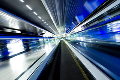 Fast moving escalator Stock Photo