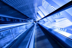 Fast moving escalator by motion Royalty Free Stock Photography
