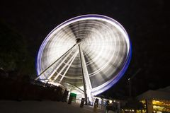 Australia - Brisbane - Fast moving ferris wheel in the city park Royalty Free Stock Images