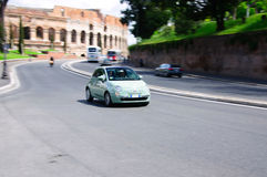 Fast moving green fiat 500 Royalty Free Stock Photos